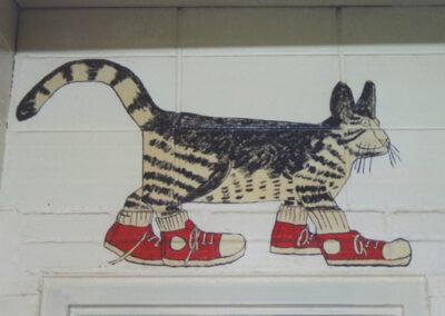 Cat wearing sneakers painting
