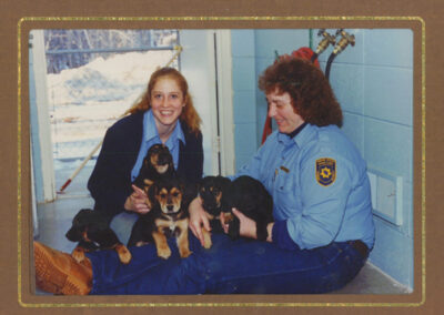 Huamane Society staff with five puppies